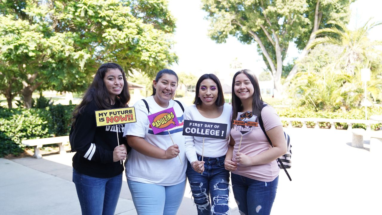 Group of students pose with college signs at FYE Expo