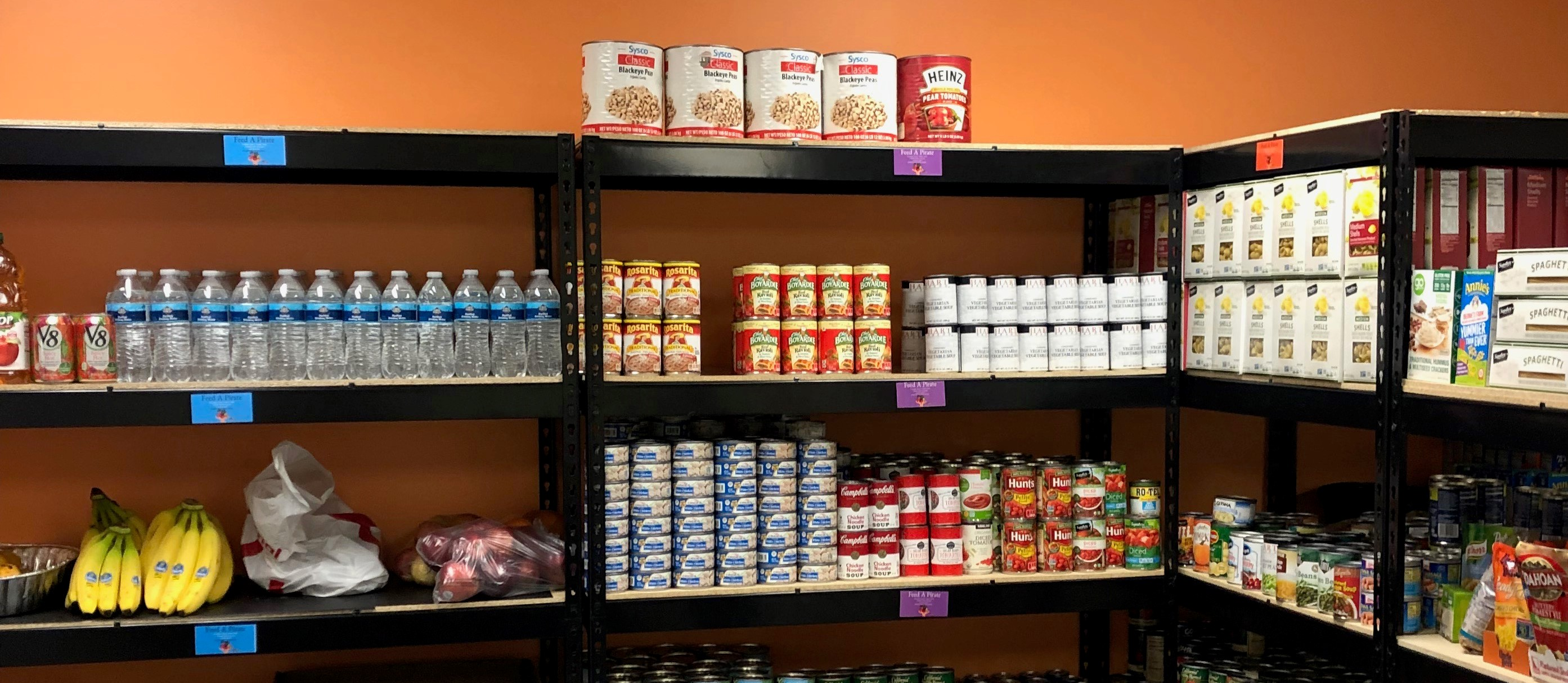 Photo of Racks of Foods and Supplies from the Food Pantry