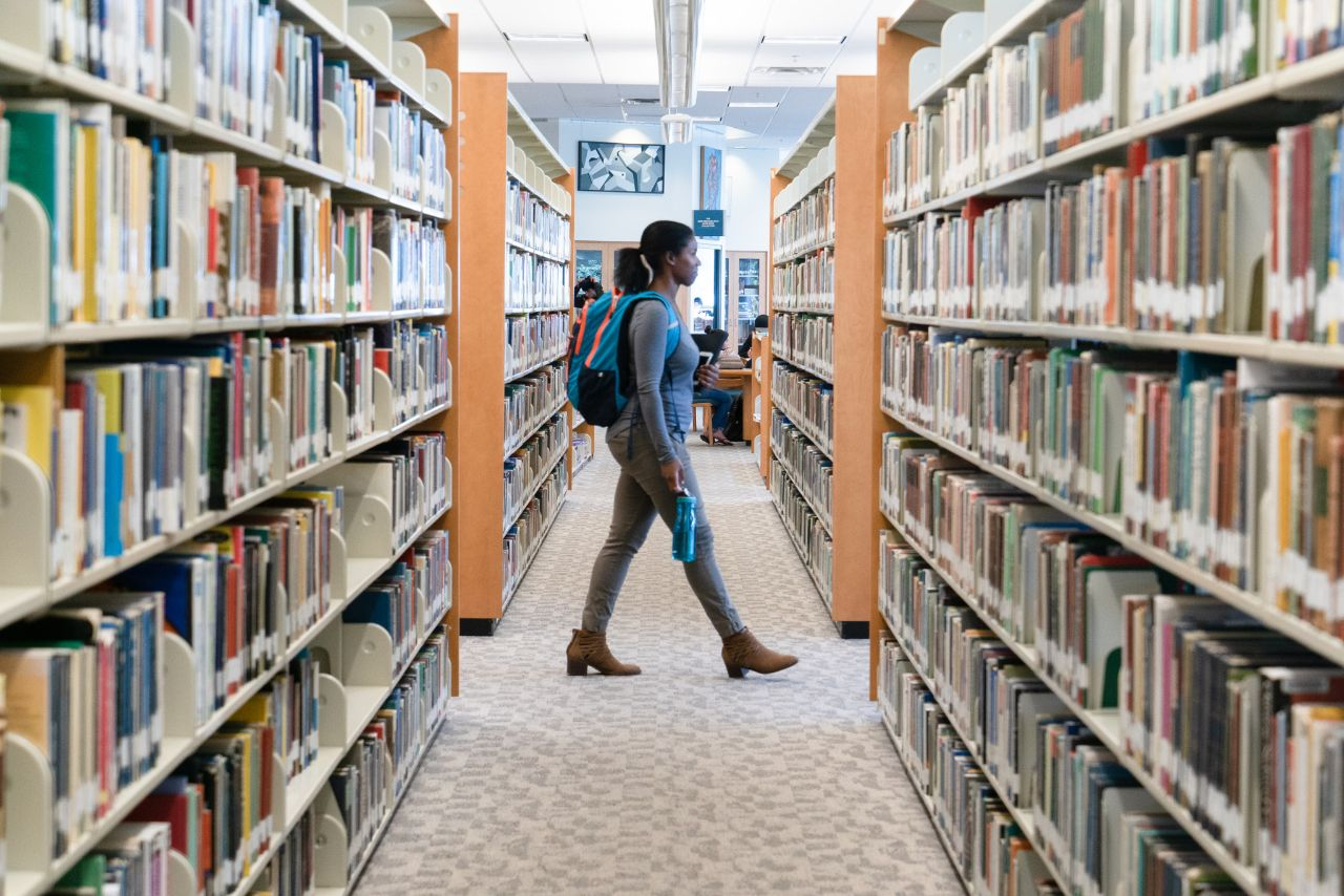 Student walks through Library