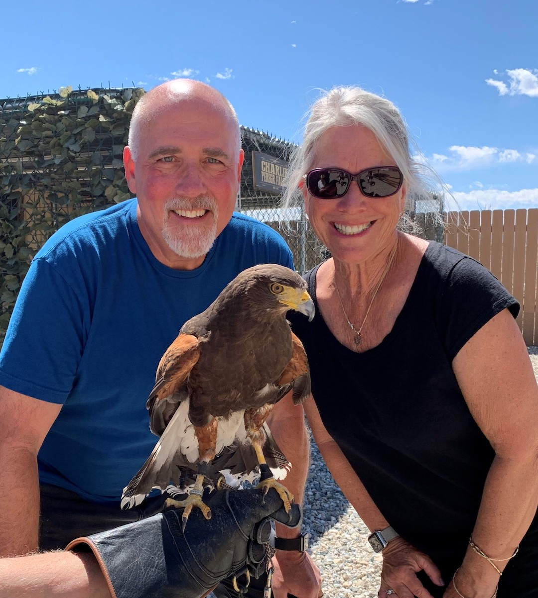 Dan Kumpf and wife with falcon.