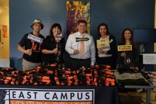 Photo of Staff at a welcome table, text below reads: VC East Campus, Dual Enrollment, and Off Campus Programs Services, Classes, and Programs Ranging from East Campus in Santa Paula, CA, to Dual Enrollment