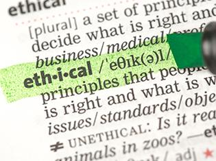 "The word ""ethical"" highlighted in a dictionary."