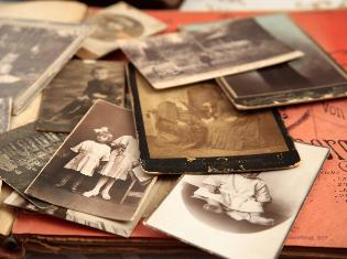 A stack of old sepia toned photographs.