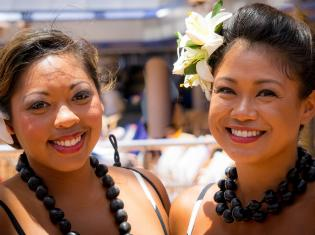 Two women of color in traditional clothing